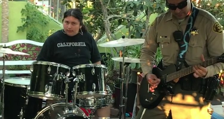 video-police-officer-jams-with-teenage-garage-band